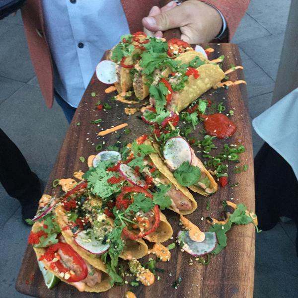 Paul McCullough serving Tuna Tacos on the Patio